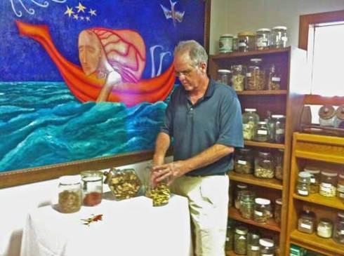Dr. Tom McCroskey preparing herbs.